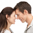 Cute young couple looking at each other head to head - Stock Photo