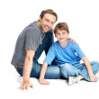 Royalty-Free Stock Photo: Handsome young man sitting with his son smiling