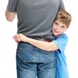 Royalty-Free Stock Photo: Happy small boy hugging his father against white