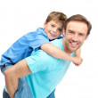 Royalty-Free Stock Photo: Handsome father giving son a piggyback ride
