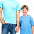 Royalty-Free Stock Photo: Cute young boy and his father holding hands
