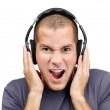 Closeup Portrait of a excited young guy listening to music - Stockfoto