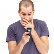Excited young man looking at mobile - Stock Photo