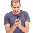 Excited young guy looking at mobile - Stock Photo