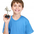 Royalty-Free Stock Photo: Footballer of the year - Cute boy with a winners trophy