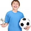 Royalty-Free Stock Photo: Excited small boy with football and a winners trophy