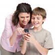 Royalty-Free Stock Photo: Happy mother and her son using a mobile phone
