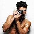 Royalty-Free Stock Photo: Sexy bodybuilder with nice biceps photographing you