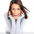 Smiling young woman with hands cupped under chin - Stock Photo