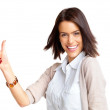 Happy young female gesturing thumbs up sign - Stock Photo