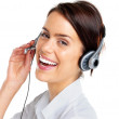 Successful female call centre employee wearing a headset - Stockfoto