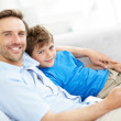 Royalty-Free Stock Photo: Happy young father and son relaxing in freetime at home