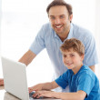 Royalty-Free Stock Photo: Cute little boy and his dad with a laptop