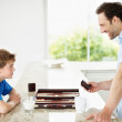 Royalty-Free Stock Photo: Relaxed father and son playing backgammon