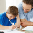 Royalty-Free Stock Photo: Cute little boy doing homework with his father