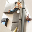Woman sitting in living room in luxurious home - Top view - ストック写真