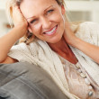 Pretty middle aged woman giving you a warm smile - Stock Photo