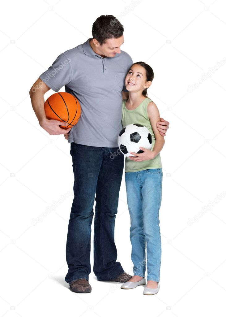 Portrait of a young man standing with his daughter holding ball over white background — Stock Photo #7720266