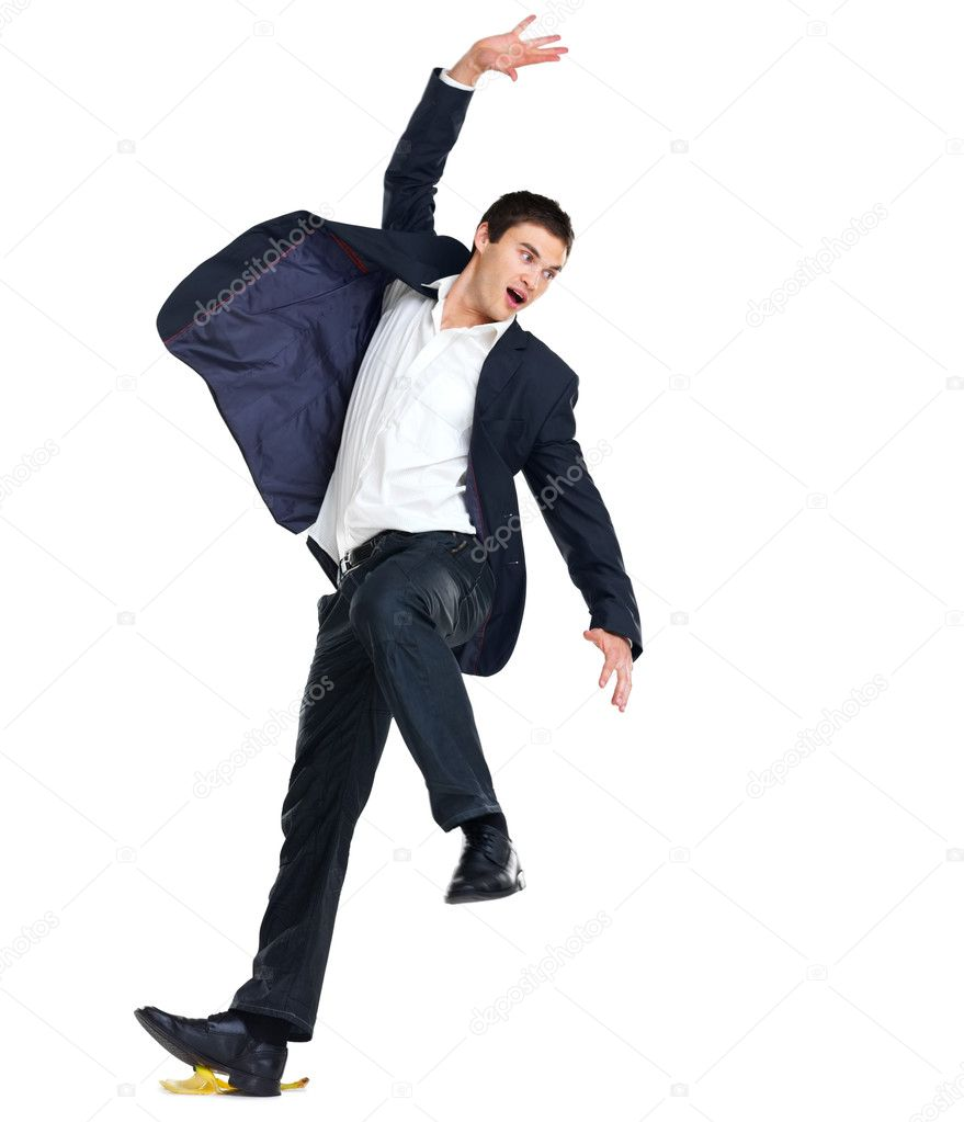 Portrait of a handsome young business man slipping on a banana peel against white background — Stock Photo #7720887