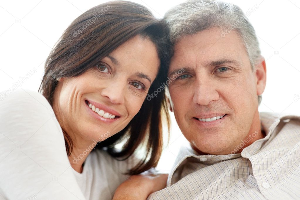 Closeup portrait of a happy mature couple looking at you — Stock Photo #7721010
