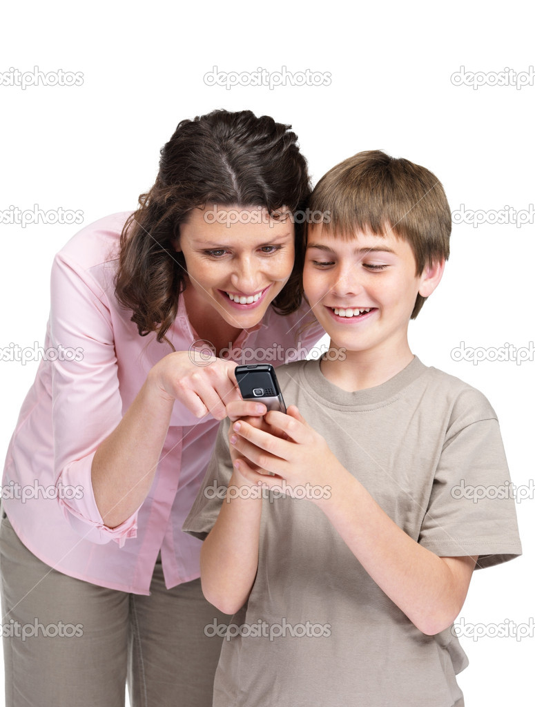 Portrait of a cute little boy showing something to his mother in cellphone against white background — Stock Photo #7722086