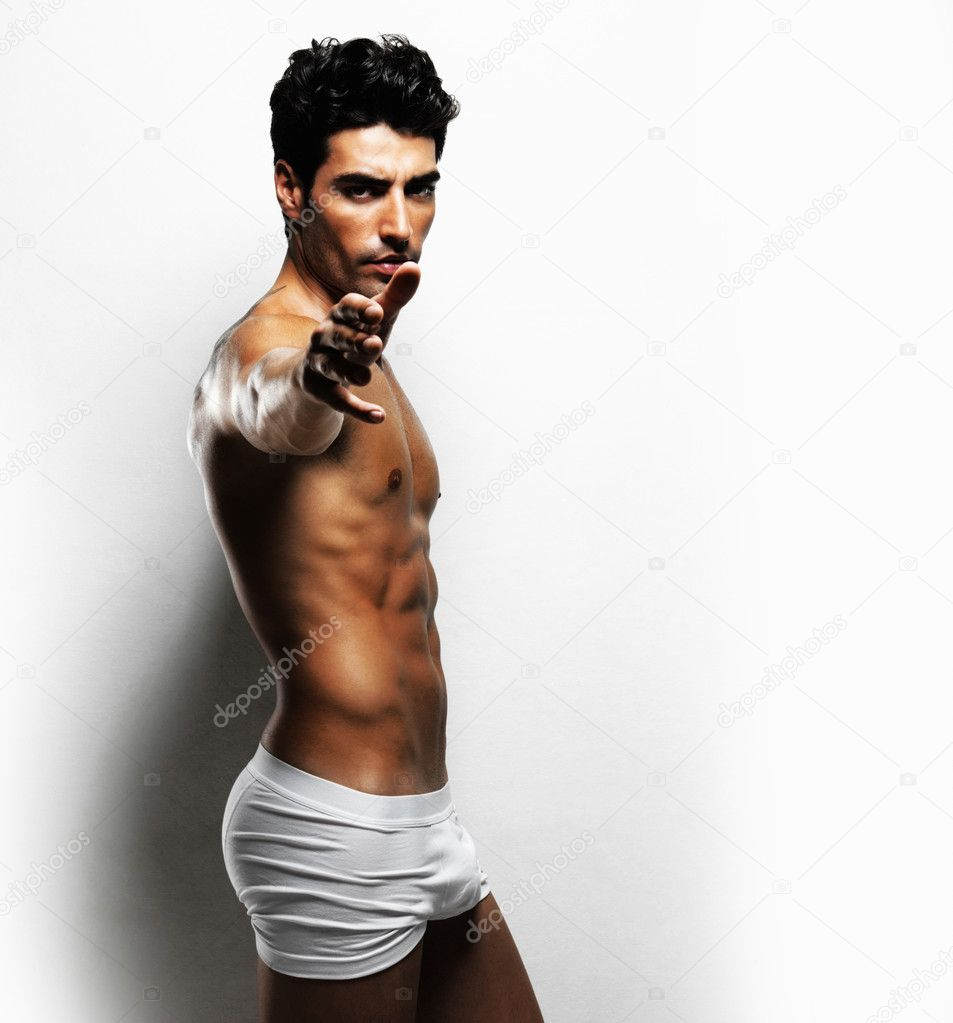 Serious sexy masculine man in underwear pointing at you against white background — Stock Photo #7722700