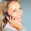 Closeup portrait of a friendly mature woman using a cellphone - Stockfoto