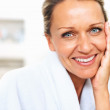 Closeup of a fresh mature woman&#039;s face smiling - Stock Photo