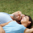 Happy young couple relaxing in a park - Photo