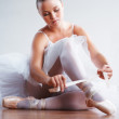 Young ballerina puts on Pointe before appearance - ストック写真