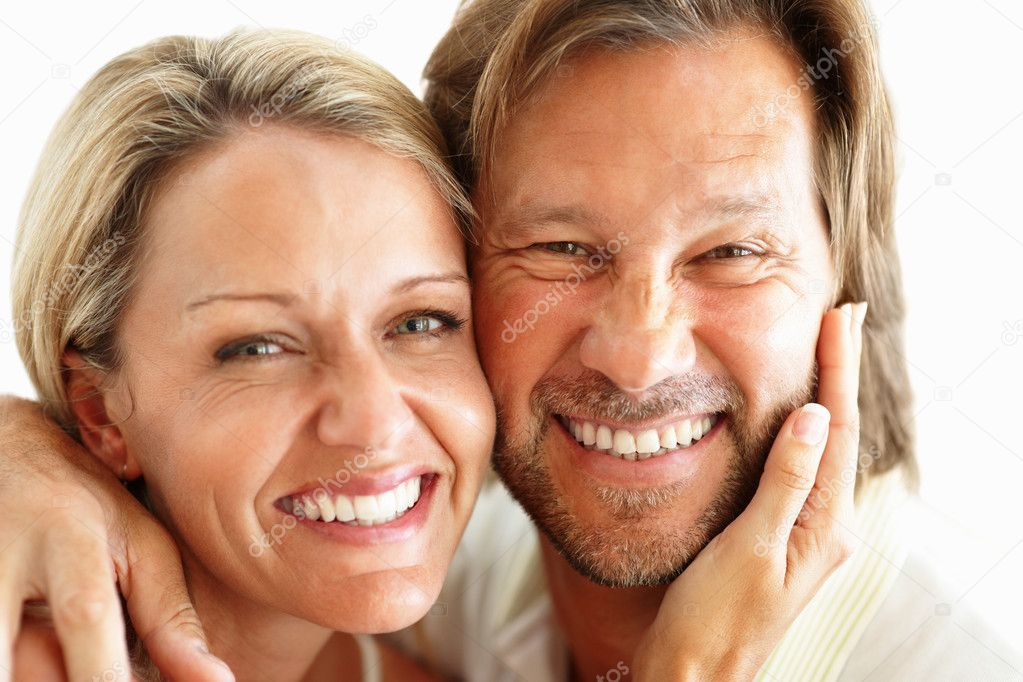 Closeup of a happy loving couple smiling together against white background — Stock Photo #7730137