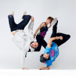 Funky hip hop group performing a cool dance act - Stock Photo