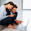 Royalty-Free Stock Photo: Couple enjoying technology