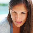 Playful woman making a silly face - Stock Photo