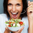 Woman ready to dig in to her salad - Stock Photo