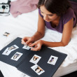 Selecting photos for album - Foto Stock
