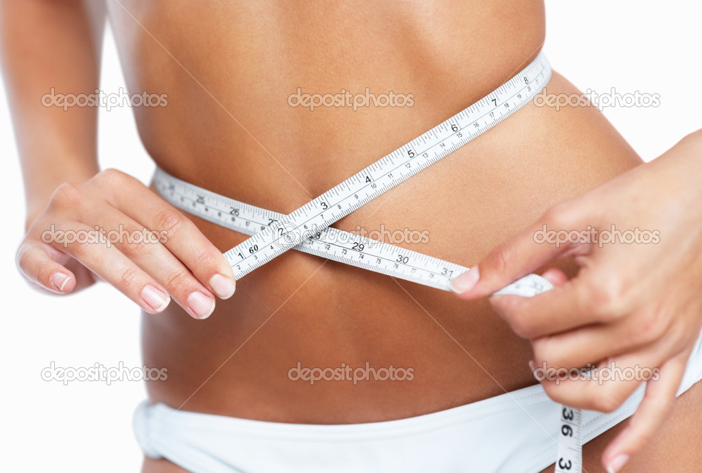 Woman measuring her waistline — Stock Photo #7743712