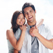Romantic young couple standing together - Photo