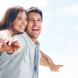 Smiling young couple enjoying their vacation - Stockfoto
