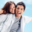 Happy young couple enjoying their summer holiday - Stockfoto