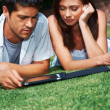 Royalty-Free Stock Photo: Loving young couple using tablet computer