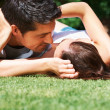 Lovely young couple sharing a passionate kiss - Photo
