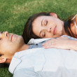 Royalty-Free Stock Photo: Cute young couple relaxing on grass