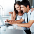 Royalty-Free Stock Photo: Beautiful young couple using laptop together