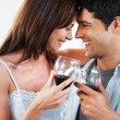 Royalty-Free Stock Photo: Enjoyment - Young couple drinking wine together