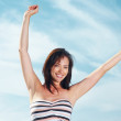 Happy young woman enjoying her summer holiday - Stock Photo