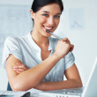 Successful young female business executive at her desk - Stock Photo