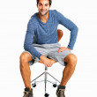 Man sitting on chair and smiling - Foto de Stock