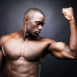 Royalty-Free Stock Photo: Masculine model showing his big biceps