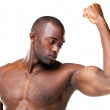 Royalty-Free Stock Photo: Healthy young man showing off his physique